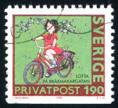SWEDEN - CIRCA 1987: stamp printed by Sweden, shows Girl on bike, circa 1987