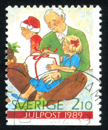 SWEDEN - CIRCA 1989: stamp printed by Sweden, shows Boy, grandfather, girl opening gift, circa 1989