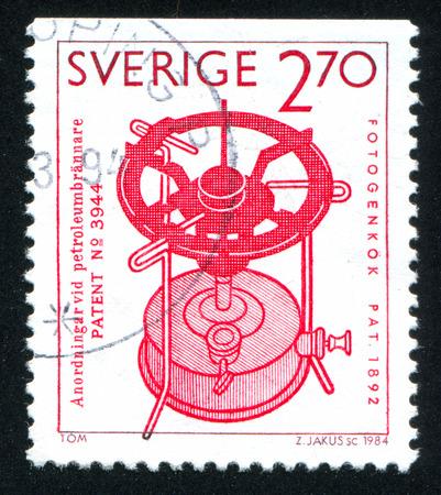 paraffine: ZWEDEN - CIRCA 1984: stempel gedrukt door Zweden, toont Paraffine fornuis, FW Lindqvist, circa 1984