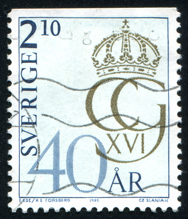surmounted: SWEDEN - CIRCA 1986: stamp printed by Sweden, shows Royal Cipher, circa 1986 Editorial
