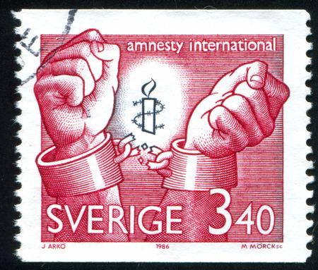 amnesty: SWEDEN - CIRCA 1986: stamp printed by Sweden, shows Amnesty International emblem, circa 1986