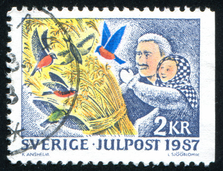 SWEDEN - CIRCA 1987: stamp printed by Sweden, shows Hanging out sheaves of wheat to foretell a good harvest, circa 1987 Stock Photo - 25694194