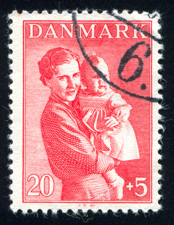 DENMARK - CIRCA 1941: stamp printed by Denmark, shows Woman and child, circa 1941
