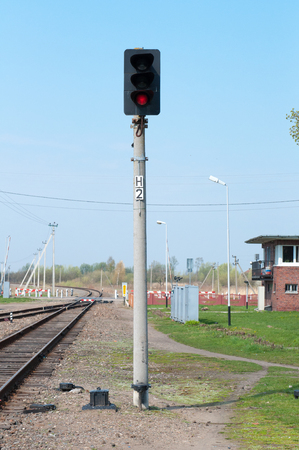 stop light: Railroad track and stop light. Traffic light shows red signal on railway.