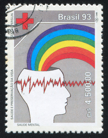 emerging: BRAZIL - CIRCA 1993: stamp printed by Brazil, shows  Red Cross emblem and Brain waves, rainbow emerging from head, circa 1993