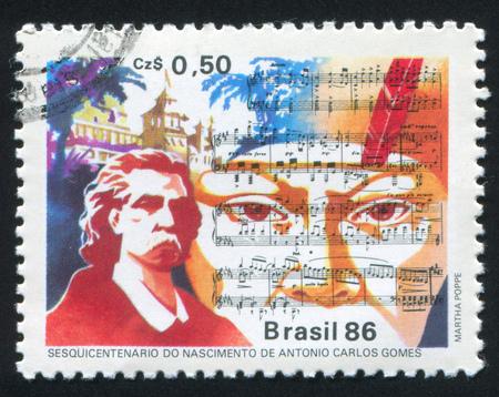 composer: BRAZIL - CIRCA 1986: stamp printed by Brazil, shows  Score from Opera Il Guarani and Antonio Carlos Gomes Composer, circa 1986 Editorial