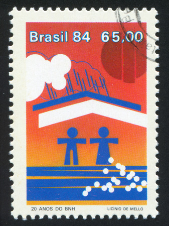 sheltered: BRAZIL - CIRCA 1984: stamp printed by Brazil, shows  Couple sheltered from rain, circa 1984