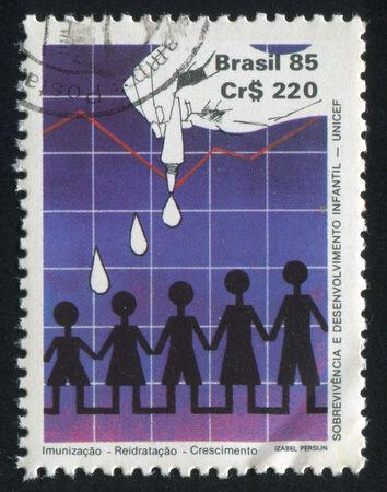 eyedropper: BRAZIL - CIRCA 1985: stamp printed by Brazil, shows  Hand eyedropper children, circa 1985