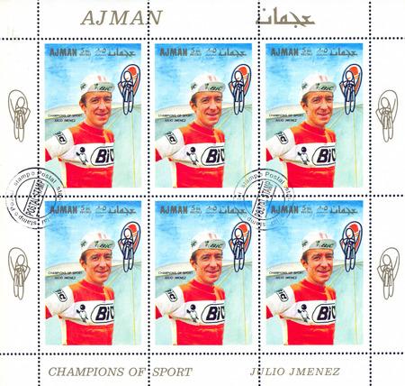 bike cover: AJMAN - CIRCA 1969: stamp printed by Ajman, shows Julio Jimenez Munoz, circa 1969