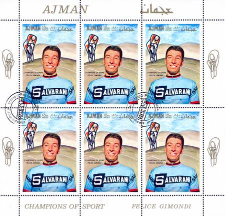 bike cover: AJMAN - CIRCA 1969: stamp printed by Ajman, shows Felice Gimondi, circa 1969 Editorial