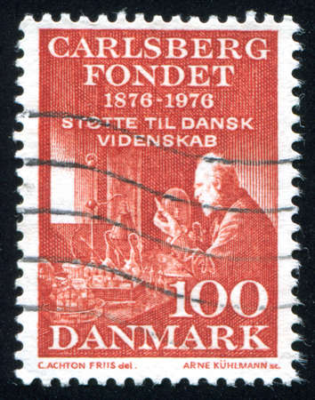 DENMARK - CIRCA 1976: stamp printed by Denmark, shows Emil Hansen Physiologist in Laboratory, circa 1976 Editorial
