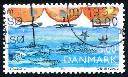 ichthyology: DENMARK - CIRCA 1992: stamp printed by Denmark, shows Fish, water pollution, circa 1992