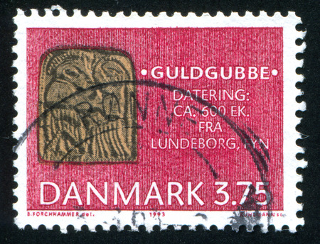 anthropomorphic: DENMARK - CIRCA 1993: stamp printed by Denmark, shows Anthropomorphic gold foil figures found in Lundeborg, circa 1993 Editorial