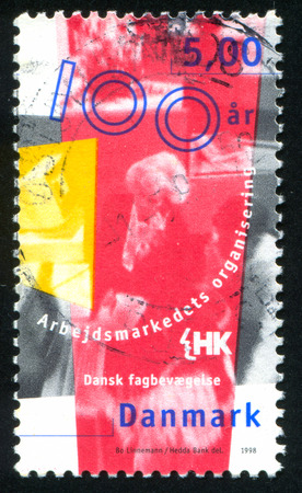 confederation: DENMARK - CIRCA 1998: stamp printed by Denmark, shows Danish Confederation of Trade Unions, Union of Commercial and Clerical Employees in Denmark, circa 1998