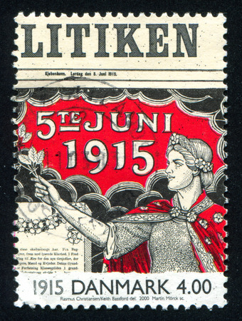 suffrage: DENMARK - CIRCA 2000: stamp printed by Denmark, shows Allegory of women suffrage on front page of newspaper, circa 2000 Editorial