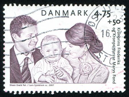 prince of denmark: DENMARK - CIRCA 2007: stamp printed by Denmark, shows Crown Prince Frederik, Crown Princess Mary, and Prince Christian, circa 2007 Editorial