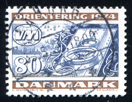 azimuth: DENMARK - CIRCA 1974: stamp printed by Denmark, shows Compass, World Orienteering Championships, circa 1974