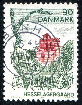 lake dwelling: DENMARK - CIRCA 1974: stamp printed by Denmark, shows Hesselagergaard, circa 1974 Editorial