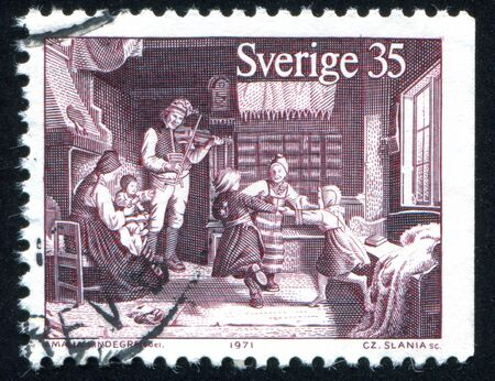fiddle: SWEDEN - CIRCA 1971: stamp printed by Sweden, shows Dancing children and father playing fiddle, circa 1971