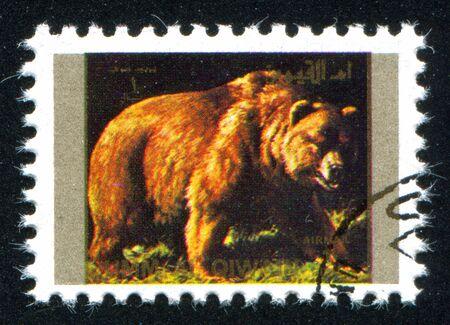 umm: UMM AL-QUWAIN - CIRCA 1972: stamp printed by Umm al-Quwain, shows wild bear, circa 1972 Editorial