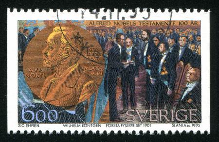 is established: SWEDEN - CIRCA 1995: stamp printed by Sweden, shows Nobel Prize Fund Established, Wilhelm Rontgen receiving the first physics prize, circa 1995