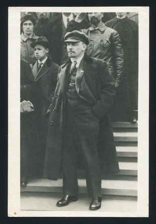 lenin: RUSSIA - CIRCA 1963: post card printed by Russia USSR, shows soviet revolutionary and politician Vladimir Lenin, Vladimir Lenin in Red Square during the May Day demonstration Moscow, May 1, 1919, circa 1963