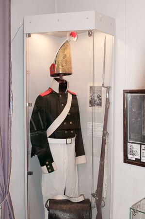 ancient soldiers: Ancient military suit. Uniform soldiers. Napoleons army. The interior of the museum. Editorial