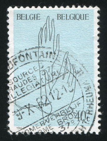 freed: BELGIUM - CIRCA 1962: stamp printed by Belgium, shows Hand with Barbed Wire and Freed  Hand, circa 1962