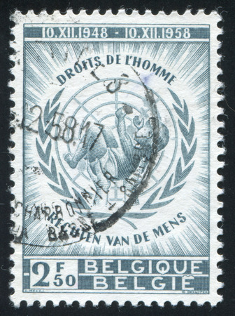 un: RUSSIA KALININGRAD, 26 OCTOBER 2015: stamp printed by Belgium, shows Universal Declaration of  Human Rights, Infant and UN Emblem, circa 1958