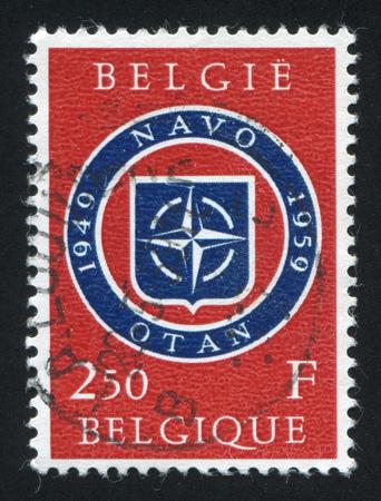 north atlantic treaty organization: BELGIUM - CIRCA 1959: stamp printed by Belgium, shows NATO Emblem, circa 1959 Editorial