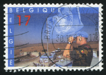 antique binoculars: RUSSIA KALININGRAD, 26 OCTOBER 2015: stamp printed by Belgium, shows UN Peace Keeping Forces, circa 1997
