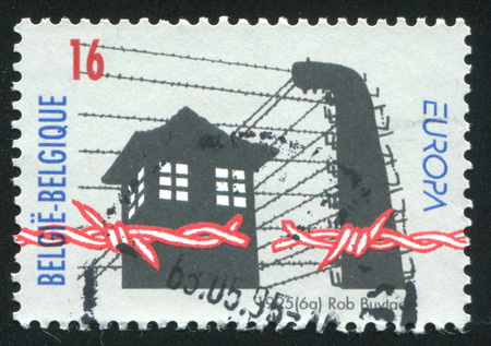 prison guard: RUSSIA KALININGRAD, 26 OCTOBER 2015: stamp printed by Belgium, shows Broken barbed wire, prison guard tower, circa 1995