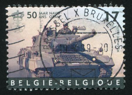 nato: RUSSIA KALININGRAD, 26 OCTOBER 2015: stamp printed by Belgium, shows Leopard tank, NATO, circa 1999