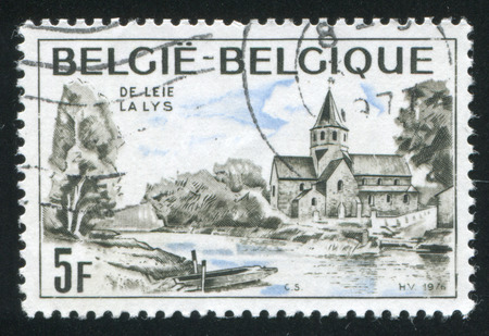 20 s: RUSSIA KALININGRAD, 20 OCTOBER 2015: stamp printed by Belgium, shows River Lys and St. Martin's Church, circa 1976