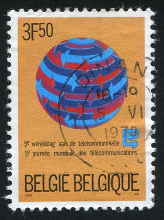 circling: RUSSIA KALININGRAD, 20 OCTOBER 2015: stamp printed by Belgium, shows Arrows Circling Globe, circa 1973