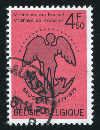 lucifer: RUSSIA KALININGRAD, 20 OCTOBER 2015: stamp printed by Belgium, shows St. Michael Banishing Lucifer, circa 1979