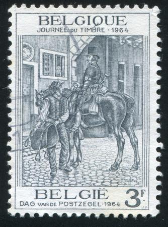 liege: RUSSIA KALININGRAD, 20 OCTOBER 2015: stamp printed by Belgium, shows Postilion of Liege, circa 1964