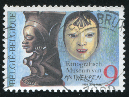 ethnographical: RUSSIA KALININGRAD, 20 OCTOBER 2015: stamp printed by Belgium, shows Statue and mask in the Antwerp Ethnographical Museum, circa 1988 Editorial