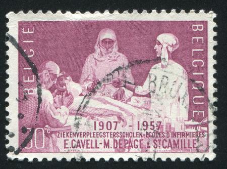 elisabeth: RUSSIA KALININGRAD, 20 OCTOBER 2015: stamp printed by Belgium, shows Queen Elisabeth Assisting at Operation, circa 1957