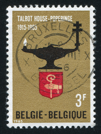 three wishes: RUSSIA KALININGRAD, 20 OCTOBER 2015: stamp printed by Belgium, shows TOC H Lamp and Arms of Poperinge, circa 1965