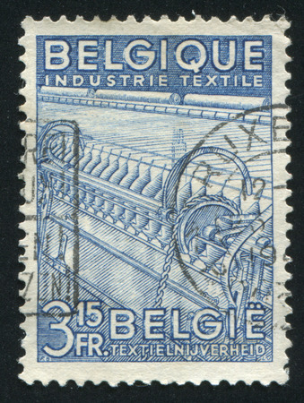 industria textil: RUSSIA KALININGRAD, 20 OCTOBER 2015: stamp printed by Belgium, shows Textile Industry, circa 1947