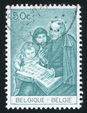 philatelist: RUSSIA KALININGRAD, 20 OCTOBER 2015: stamp printed by Belgium, shows Sir Rowland Hill as Philatelist, circa 1965