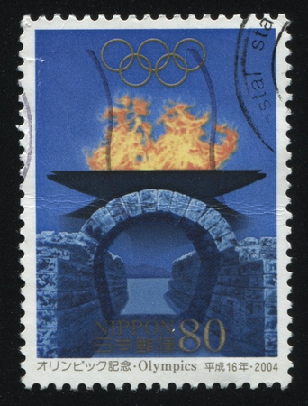 ancient olympic games: RUSSIA KALININGRAD, 16 MARCH 2016: stamp printed by Japan shows Olympic flame, circa 2004 Editorial
