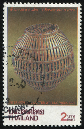 interleaved: RUSSIA KALININGRAD, 31 MAY 2016: stamp printed by Thailand, shows wicker basket, dedicated to international letter writing week, circa 1995 Editorial