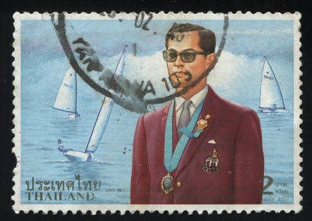 adulyadej: RUSSIA KALININGRAD, 31 MAY 2016: stamp printed by Thailand shows King Bhumibol Adulyadej, circa 1997 Editorial