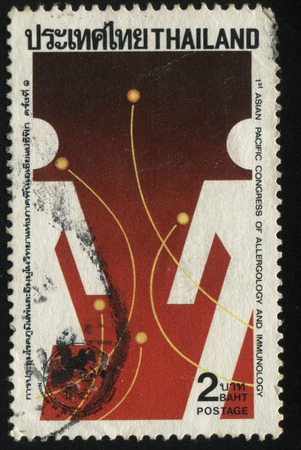 fastness: RUSSIA KALININGRAD, 31 MAY 2016: stamp printed by Thailand, shows abstract man and women on red background , circa 1992 Editorial