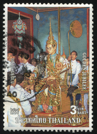 adulyadej: RUSSIA KALININGRAD, 31 MAY 2016: stamp printed by Thailand, shows painting of King Bhumibol Adulyadej in palace with his lieges, dedicated to golden jubilee, circa 1996