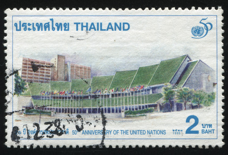nations: RUSSIA KALININGRAD, 31 MAY 2016: stamp printed by Thailand, shows illustration of United Nations Organization, dedicated to 50th anniversary of the united nations, circa 1995 Editorial
