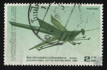 adroitness: RUSSIA KALININGRAD, 2 JUNE 2016: stamp printed by Thailand, shows a green grasshopper from the paper, circa 1988
