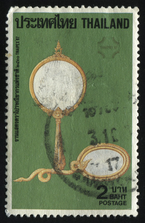 speculum: RUSSIA KALININGRAD, 2 JUNE 2016: stamp printed by Thailand, shows two hand mirrors, circa 1987